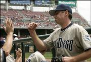 San Diego pitcher Tim Stauffer accepts congratulations after earning his first major-league victory. The Padres defeated the Reds, 7-2, Wednesday in Cincinnati.