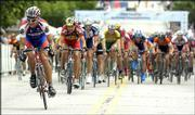 Kansas University cyclist Brian Jensen, left, leads the pack on the final lap of the men's Division One one-mile criterium during the National Collegiate Cycling Championships. Jensen faded to 14th place in the race Friday in downtown Lawrence.
