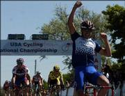 Penn State cyclist Bobby Lea pumps his fist after winning the men's Division One road race at the National Collegiate Cycling Championships. Lee won the race -- and Kansas University's Brian Jensen, left, was third -- Saturday at Perry Lake.