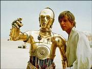 "Mark Hamill portrays Luke Skywalker in this scene from the initial ""Star Wars"" release with the droll droid C-3PO."
