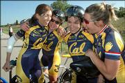 Cal-Berkeley cyclists, from left, Stefanie Graeter, Michelle Gibson, Martina Patella and Marcela Smid, celebrate their victory in the women's Divison One team time trial. The women won the stage Sunday on the South Lawrence Trafficway.