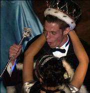 Free State High School's prom king Aaron Trent dances with prom queen Dulce Shultz.
