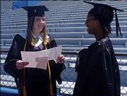 Lawrence High seniors, from left, Julia Szabo and Kondja Kamatuka practice their senior speeches before the 121st commencement ceremony Sunday. The afternoon ceremony was held at Kansas University's Memorial Stadium.