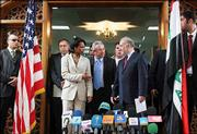 U.S. Secretary of State Condoleezza Rice reaches out to shake hands with Iraqi Prime Minister Ibrahim al-Jaafari at a press conference in Baghdad. Rice arrived Sunday under very heavy security to meet Iraqi leaders grappling with a wave of insurgent attacks that have killed more than 400 people since a new government was formed on April 28.