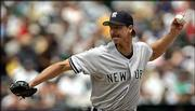New York Yankees pitcher Randy Johnson deals in the first inning against the Athletics. Johnson became the 42nd pitcher to reach 250 victories, downing Oakland, 6-4, Sunday in Oakland, Calif.