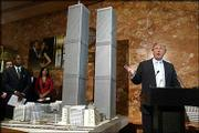 "Real estate developer Donald Trump addresses reporters next to a model of the proposed World Trade Center known as the ""Twin Towers II"" in New York. Trump is supporting this design by architects Kenneth Gardner, left, and Herbert Belton, not in photo. The original twin towers were destroyed 9-11."