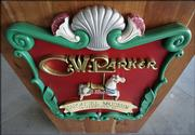 An ornate, handmade sign hangs on a speaker's stand in the the C.W. Parker Carousel Museum in Leavenworth.