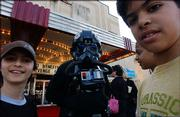"Characters from Star Wars movies mingle with kids outside the Uptown Theater in Washington, D.C. during the premiere of ""Star Wars: Episode III - Revenge of the Sith."