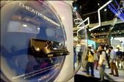 A model of Nyko Technologies' Theater Experience PSP is displayed at the Electronic Entertainment Expo in Los Angeles. Nyko says the device will enhance the experience of watching movies on the Sony PSP.