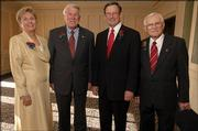 Kansas University's 2005 Distinguished Service Citation recipients, from left, are Kala Mays Stroup, of Lawrence, Paul Adam Jr., of Overland Park, Forrest Hoglund, of Dallas, and Delbert Shankel, of Lawrence. The four were pictured during a reception at the Adams Alumni Center before the All-University Supper on Friday at KU.