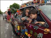 """Layla Wilson, left, and Benjamin Slimmer peek out of the """"Toy Car."""" The two participated in the Art Tougeau Parade in 2002."""