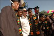 Kansas men's basketball coach Bill Self, in white, poses with graduating players, from left, Wayne Simien, Aaron Miles, Michael Lee, Keith Langford and Jeff Hawkins. All five players graduated in four years and walked down Campanile Hill on Sunday afternoon.