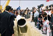 Officials and reporters attend a groundbreaking ceremony of construction of the Baku-Ceyhan oil pipeline in Sangachal, Azerbaijan, Wednesday, in this Sept. 18, 2002, file photo. The 1,100-mile Baku-Ceyhan pipeline to be inaugurated today will not only bring Caspian oil to the West but could help bring stability to a troubled region, analysts say.