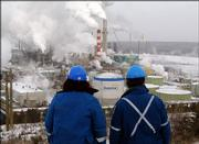 Workers overlook a processing plant at the Suncor tar sands project in Fort McMurray, Alberta. About 8 percent of Canada's oil production comes from tar sands, although it takes energy in the form of natural gas to heat water for the oil recovery.
