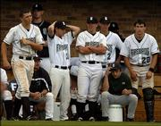 Free State high baseball players react after their season-ending loss against Shawnee Mission Northwest. The Cougars beat the Firebirds, 5-4, Friday afternoon in the Class 6A state tournament at Hoglund Ballpark.
