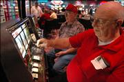 Dick Carpenter, front, of Kansas City, Mo., and Marvin Starr, of Holton, play nickel slots at the Golden Eagle Casino, which is operated by the Kickapoo Tribe west of Holton. The casino is a vital moneymaker for the tribe, helping to pay for just about everything from the police force to schools and health care. Carpenter and Starr said they preferred the casino over the Kansas City ones because the slots take real nickels, not tokens.