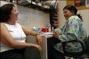 Jeanne Krehbiel, left, director of the Kickapoo Nation Health Center and Angie Ramirez, a nurse at the clinic, visit Wednesday at the clinic. Krehbiel said the clinic wouldn't exist if it weren't for the money generated by the tribe's casino.