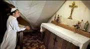 David Bawden, who has taken the name Pope Michael I, prays in a chapel in the attic of his home near Delia. Bawden has claimed to be the rightful leader of the Catholic Church since he was elected by a handful of traditionalist Catholics in 1990.