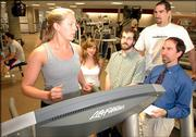 Kansas University psychology graduate students, from left, Jennifer Prohaska, Leslie Karwoski, Andy Lehman, Chris Heath and professor Stephen Ilardi are working on an alternative to drug therapy for treating depression. The program uses aerobic exercise, light therapy and other treatments to combat depression in people who aren't responding to prescription drugs. The group is pictured at the KU Student Recreation Center in this 2005 file photo.
