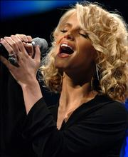 "Singer Jessica Simpson performs ""The Star-Spangled Banner,"" during the the Wal-Mart shareholders meeting."