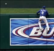 Kansas City center fielder David Dejesus comes up short as Alfonso Soriano's home run sails over the wall. The Texas Rangers beat the Royals, 14-9, Saturday in Kansas City, Mo.