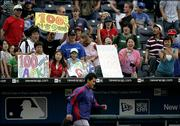 Texas pitcher Chan Ho Park, of South Korea, is cheered by fans after the Rangers beat the Royals, 14-9. Park earned his 100th career victory Saturday at Kauffman Stadium in Kansas City, Mo.
