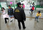 "Wearing a jacket that reads: ""Elder Adult Police,"" Jose Luis Ramirez Garcia, 60, keeps an eye outside of an elementary school in Ciudad Juarez, Mexico."