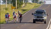 A pickup truck passes a group of bicyclists from the Lawrence Bicycle Club as they ride Wednesday on County Road1055 south of Lawrence. Cyclists often head out of town to avoid the heavy traffic of the city. In town, however, both bicyclists and motorists must obey the rules of the road, and it doesn't hurt to remember that a little courtesy goes a long way for both sides.