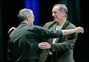 Apple Computer Inc. CEO Steve Jobs, left, hugs Intel Corp. CEO Paul Otellini at Apple's Worldwide Developers Conference in San Francisco. Apple announced it would discontinue using microprocessor chips made by IBM in favor of Intel chips.
