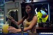 Aya Patterson, Lawrence, a bartender at the Moon Bar, pours a drink Tuesday night. The bar is decorated in an Asian motif, including stained-glass artwork of geisha girls behind the bar.