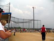 Clouds built up during the first game of a 16-U Phenix-Fyler doubleheader on June 8 at Mid-America West in Shawnee. The second game was rained out in the second inning.