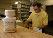 Orchards Drug was burglarized last November, and the thieves made off with narcotic painkillers such as OxyContin. OxyContin abuse is rising nationwide, as well as in Lawrence. Pharmacist Mark Smith is pictured filling a prescription Thursday.