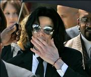 Michael Jackson blows a kiss to his fans as he leaves the Santa Barbara County Courthouse in Santa Maria, Calif. The jury in the Jackson child molestation case found the pop star not guilty on all counts Monday.