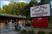 Patrons enter Slow Ride Roadhouse Bar & Grill, 1350 N. Third St. The restaurant caters to biker-friendly crowds and has drawn steady business since opening in late April.