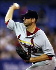 St. Louis' Chris Carpenter delivers against Toronto. Carpenter pitched a one-hitter as the Cardinals blanked the Blue Jays, 7-0, Tuesday night in Toronto.