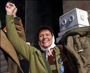 "Taty Almeyda, a member of the human rights group Mothers of Plaza de Mayo, reacts outside the Buenos Aires Courthouse after Argentina&squot;s Supreme Court ruled that laws granting amnesty for atrocities committed during the so-called ""Dirty War"" were unconstitutional. The ruling opens the possibility that hundreds of people could be brought back to court."