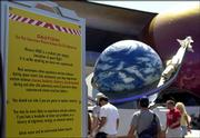 "A caution sign alerts guests at Walt Disney World&squot;s ""Mission: Space"" that they may experience motion sickness during the ride in Lake Buena Vista, Fla., in this May 5, 2004, file photo. A 4-year-old boy from Sellersville, Pa., died after passing out aboard ""Mission: Space"" on Monday."
