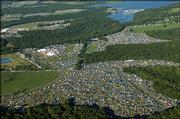 An aerial view of the Wakarusa Music & Camping Festival shows campsites in the bottom half, the main performance stages at upper left, and the Clinton Lake Marina at upper right on Saturday. About 15,000 attended the event, which began Thursday and ends today.