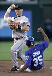 Houston's Craig Biggio, left, throws to first for a double play after forcing out Kansas City's Emil Brown.