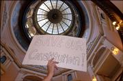 A GOP supporter waives a sign critical of the Kansas Supreme Court, which conservatives argue is overstepping its power and is in conflict with the constitution's separation of powers.