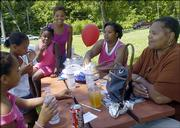 From left, Aliyah Wycoff, Keyahna Glass, Tahisa Wycoff, Darcy Tolbert, Tracy Tolbert and Debi Tolbert, all from Lawrence take a sit-down break Saturday during the Juneteenth celebration at Burcham Park.