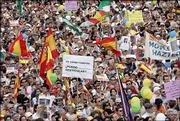 Hundreds of thousands of people march in the Plaza del Sol in the center of Madrid on Saturday to protest against the Socialist government's bill to legalize gay marriage.