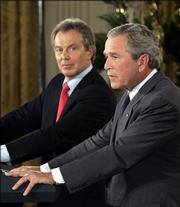 Six months after 9-11, British officials and Prime Minister Tony Blair, shown at left in the file photo with President Bush, worried the White House was rushing to war, according to a series of leaked secret Downing Street memos that have renewed questions about Washington's motives for ousting Saddam Hussein.