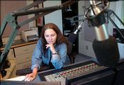 Cordelia Brown, operations manager at KANU, 91.5 FM radio, works her classical music programming shift at the Lawrence Kansas Public Radio studio. Kansas public radio and TV outlets could be affected by proposed congressional funding cuts.