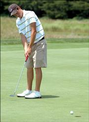 Jason Schulte watches his putt go in on the 12th hole during the Kansas Golf Assn. Junior Amateur Championship. Shulte, who won the event in 2003, shot a 5-under-par 67 Tuesday at Eagle Bend Golf Course.