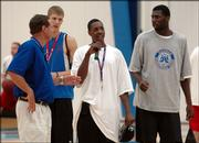 Kansas University coach Bill Self, left, introduces the incoming freshmen, from left, Micah Downs, Mario Chalmers and Julian Wright during Self's basketball camp. The Jayhawks held a workout to show the campers how hard they work between games during camp Tuesday at Horejsi Center.