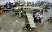 Workers assemble a Cessna Citation Mustang business jet Wednesday at a Cessna facility in Wichita. Cessna has more than 200 orders for the entry-level business jet.