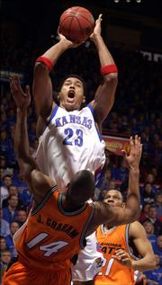 As Oklahoma State's Joey Graham (14) found out, Kansas University's Wayne Simien (23) could be a force inside. Against the Cowboys on Feb. 27, Simien collected 32 points and 12 rebounds in KU's 81-79 victory.