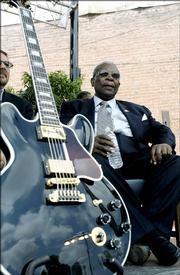 Blues legend B.B. King shares the shade with his beloved guitar, Lucille, while waiting for the groundbreaking ceremonies to begin for the B.B. King Museum and Delta Interpretive Center on June 10 in Indianola, Miss.