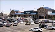 A Super Wal-Mart store is pictured in Centennial, Colo., featuring a timber roof style to suit the community's standards. Faced with controversy when it moves into new towns, Wal-Mart has created a new prototype that features a broken plane - different levels of roof tops - enabling it to be more easily customized to different communities.